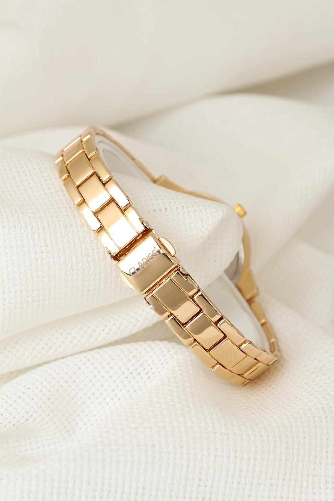 Gold Renk Metal Kordonlu Sarı Renk Zirkon Taşlı İç Tasarımlı Clariss Marka Bayan Kol Saati
